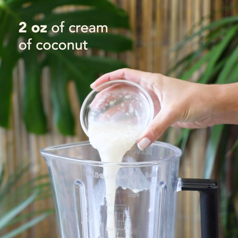 Adding 2oz cream of coconut to a blender
