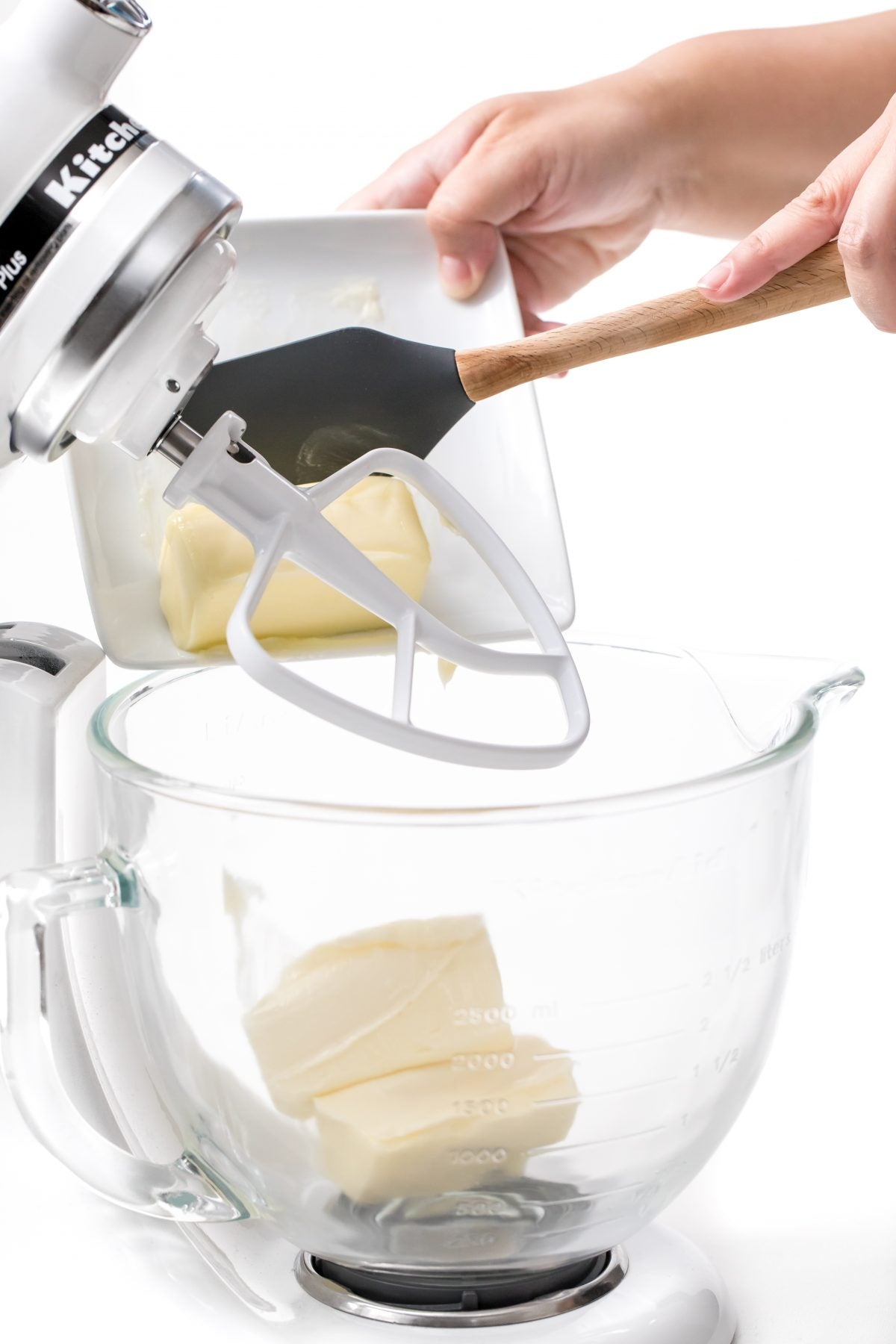BEGIN BUTTER CREAM ICING BY ADDING BUTTER TO MIXER