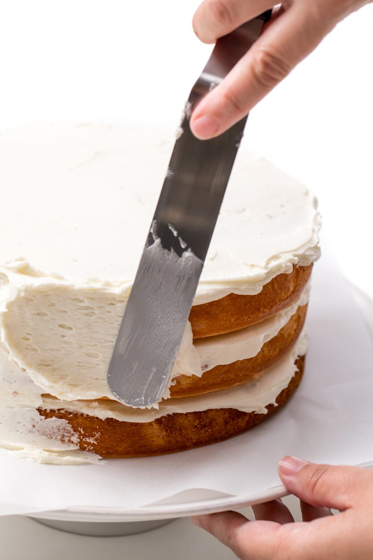 APPLY BUTTER CREAM ICING TO SIDES OF CAKE
