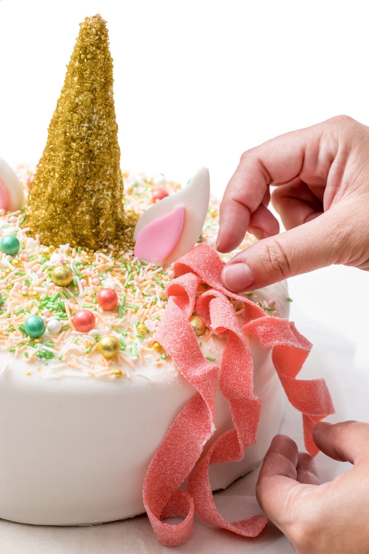 PLACE CANDY STRIPS ON CAKE BY PRESSING ON ONE END AND TWISTING THEM.