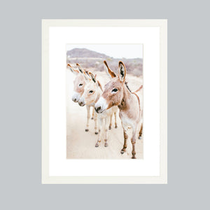 A small fine art print in a white wood gallery frame.
