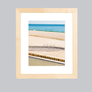 A natural wood frame showcasing a fine art print of Baja beaches.