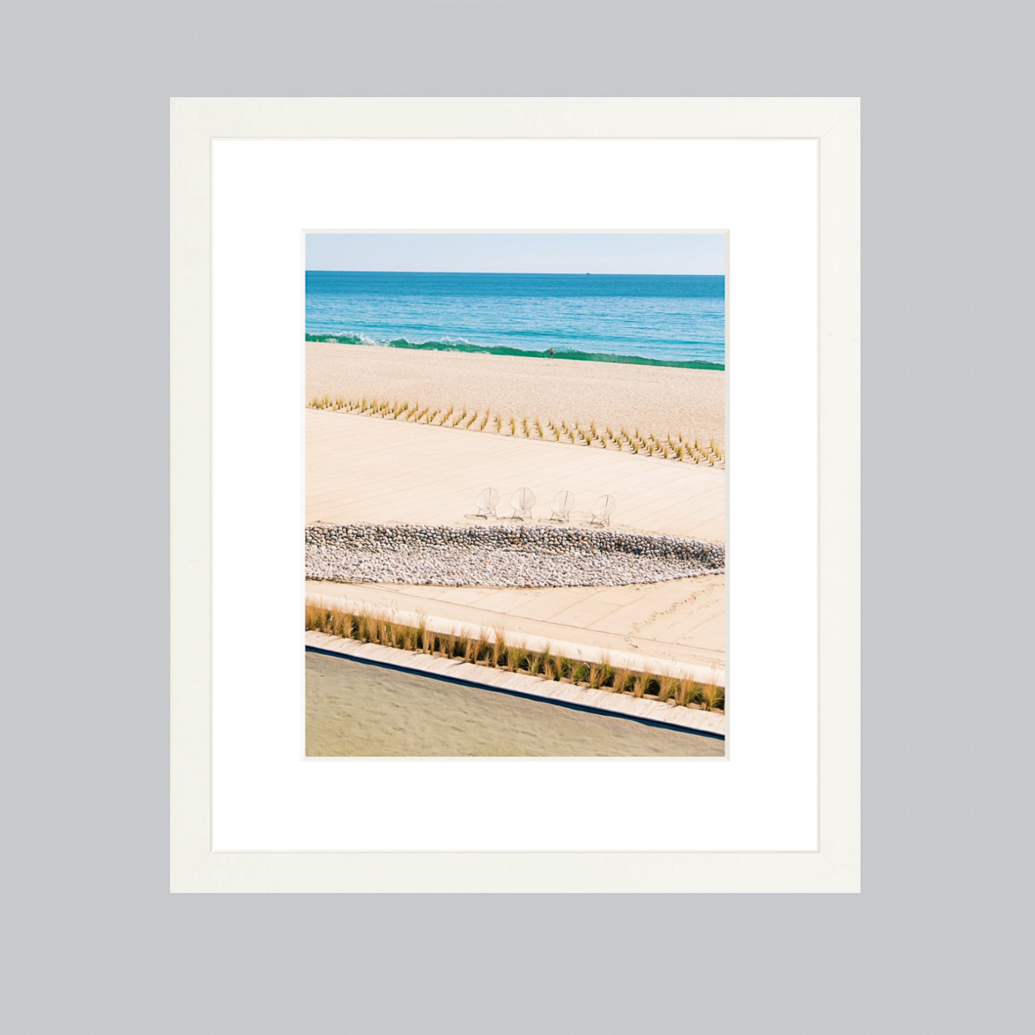 A white wood frame showcasing a fine art photo of Baja beaches.