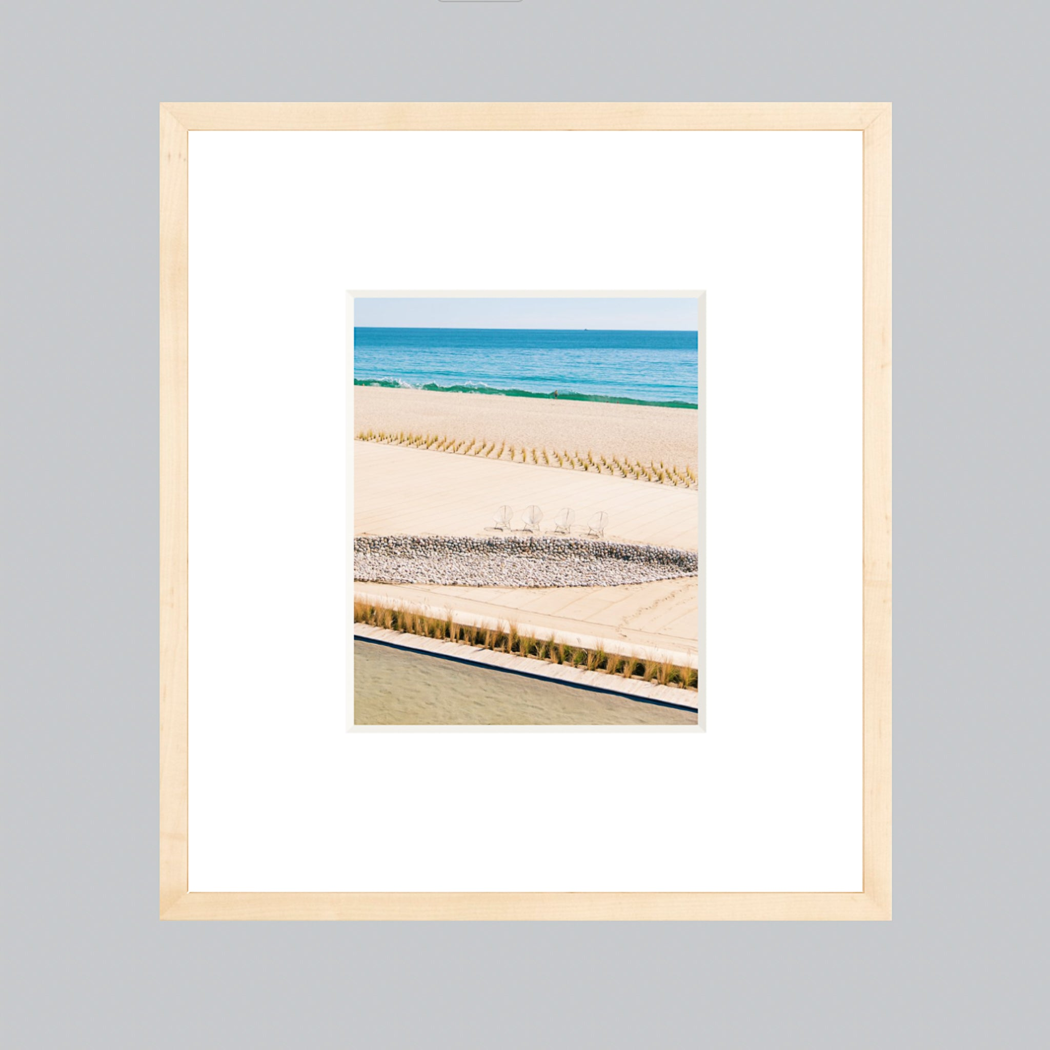 A fine art photo framed in a natural wood frame with an extra-large mat.