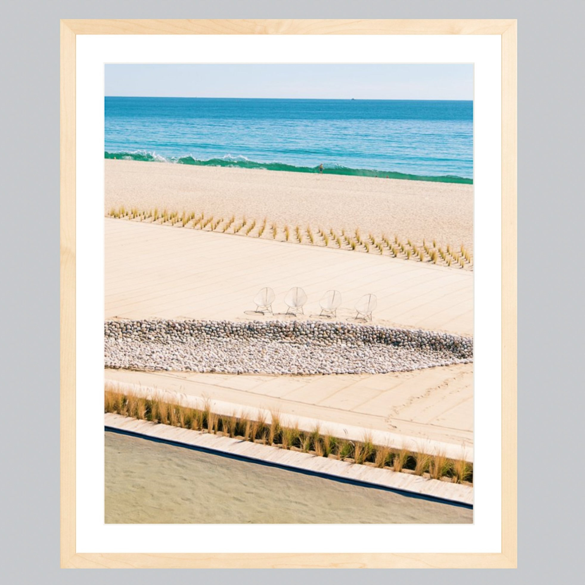 A fine art print featuring Baja beaches in a natural wood frame.