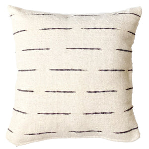 An ivory throw pillow with black stripes, handwoven with wool in Guanajuato, Mexico..