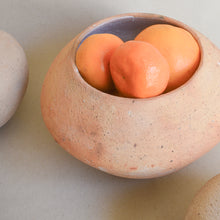 Load image into Gallery viewer, A large terracotta ceramic vase filled with oranges.