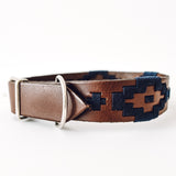 Leather dog collar with metal leash loop and metal buckle and navy blue woven design.