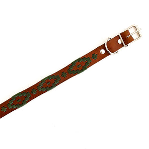 Leather dog collar made in Mexico with metal buckle and clasp and dark green woven design.