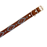 Leather dog collar made in Mexico with metal buckle and clasp and silver woven design.