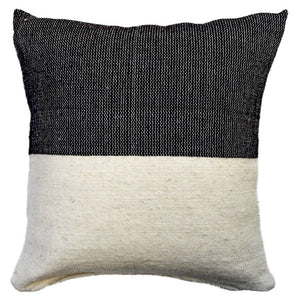 A black and ivory wool throw pillow, handwoven in Guanajuato, Mexico.