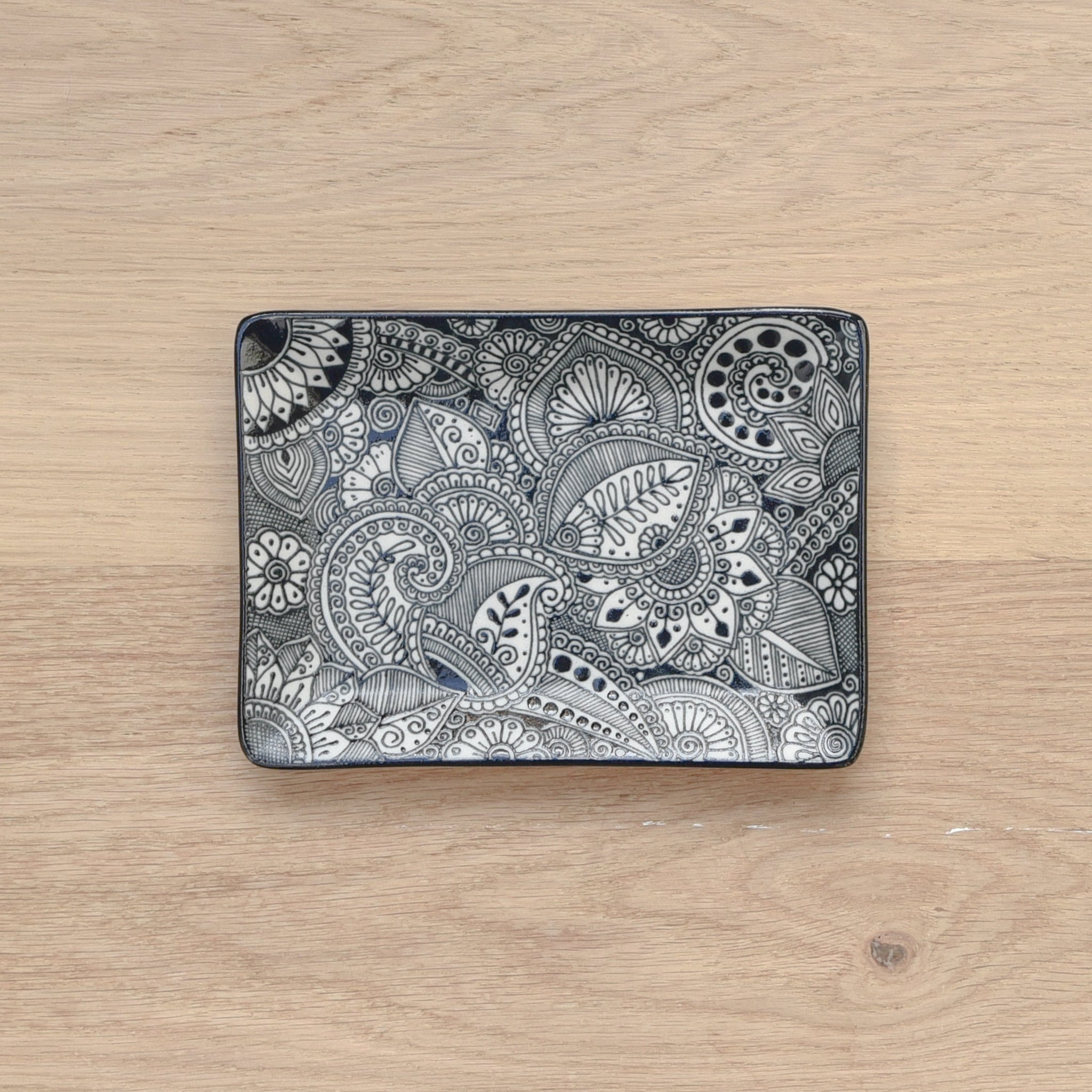 Handpainted Talavera-style ceramic tray in modern, black and white colors.