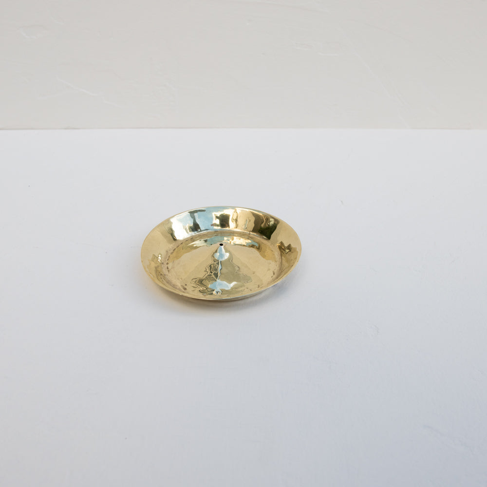 Modern brass incense holder.