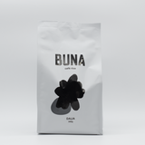 A bag of Buna whole bean coffee.
