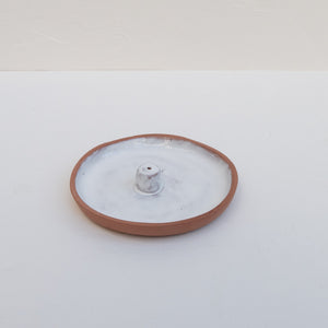 The Artesanal ceramic incense holder in white.