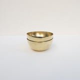 Small brass bowls.