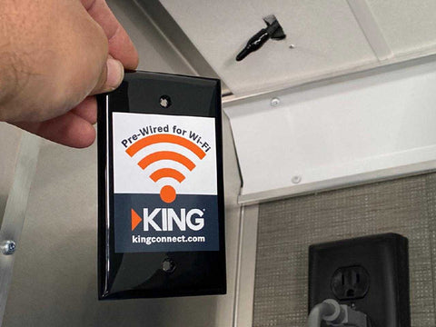 The King Connect Pre-Wire for Wi-Fi Faceplate, with Coaxial Cable hanging out of the ceiling