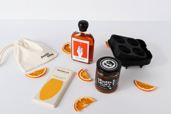 cocktail hamper with relish and chocolate