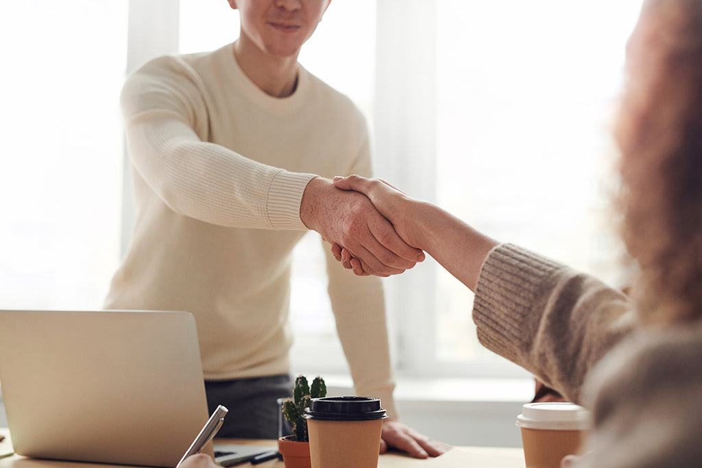 Shaking hands with a corporate client