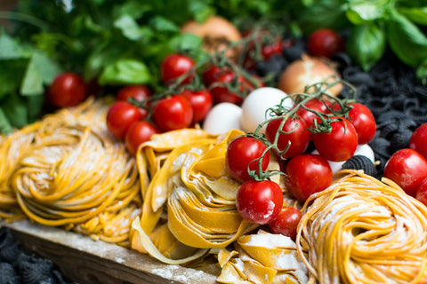 Fresh pasta with cherry tomatoes and greens