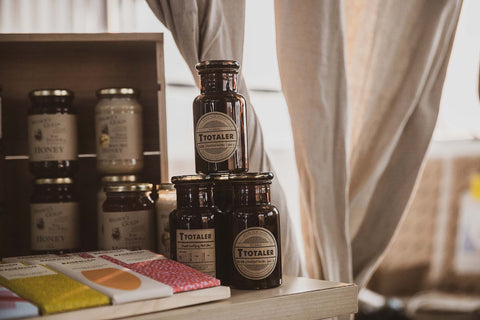 Collection herbal tea by T Totaler beside handmade chocolate
