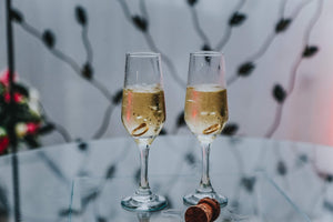 Champagne glasses with wedding rings