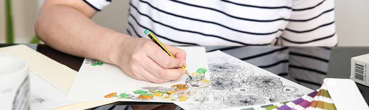 Megan Isabella drawing in the studio