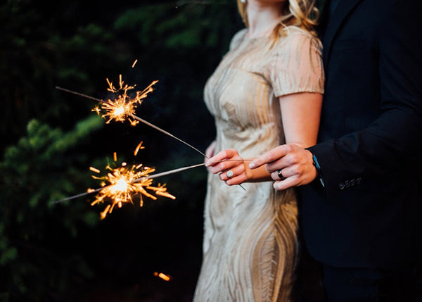 Couple Holding Sparklers to Celebrate Anniversary