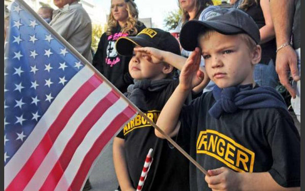 kids holding the American Flag