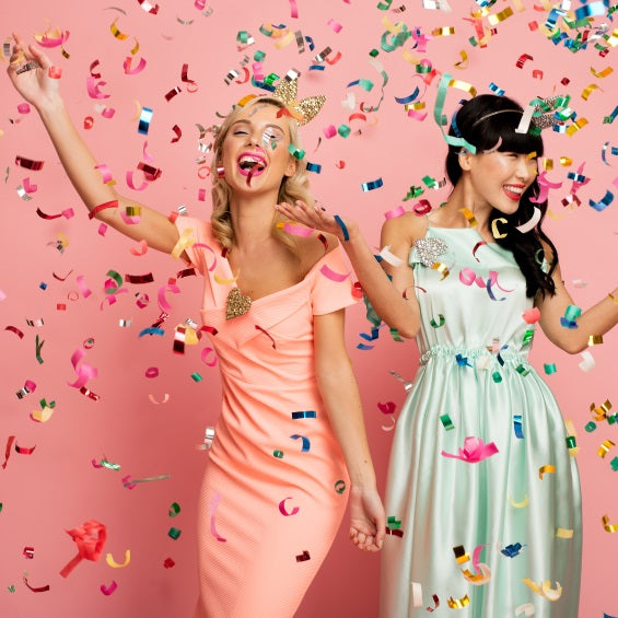 Two Young Women Under a Confetti Cannon
