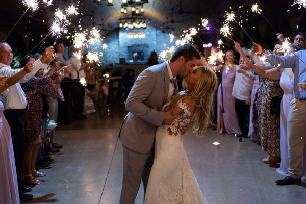 Wedding Kiss Under Crowd of Sparklers