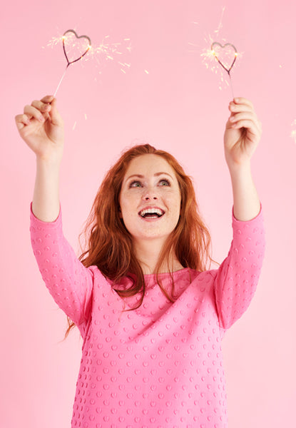Woman in Pink Holding Heart Shaped Sparklers