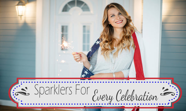 woman holding sparkler in front of house