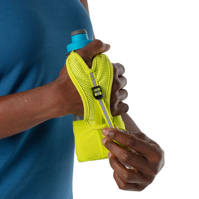 NATHAN QuickSqueeze Lite 12oz Insulated Hydration Handheld - Finish Lime/Blue Me Away - Runner Pulling Strap to Tighten Handheld Around the Palm