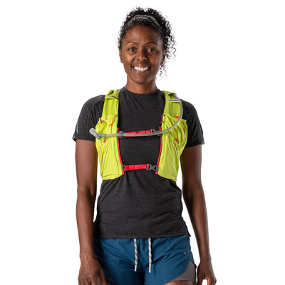 NATHAN Pinnacle 12 Liter Women's Hydration Race Vest - Finish Lime/Hibiscus Red - Female Runner Front View