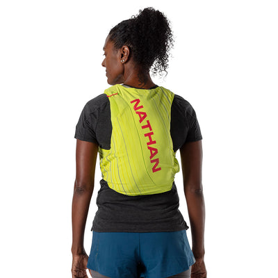 NATHAN Pinnacle 12 Liter Women's Hydration Race Vest - Finish Lime/Hibiscus Red - Female Runner Back View