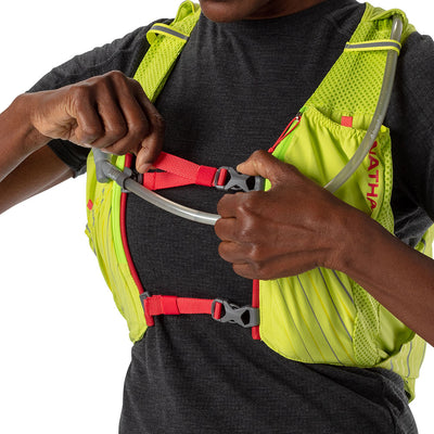 NATHAN Pinnacle 12 Liter Women's Hydration Race Vest - Finish Lime/Hibiscus Red - Female Runner Tightening Straps on Vest For Better Fit