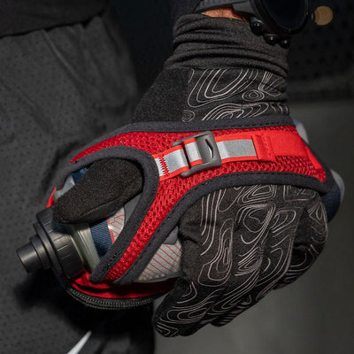 Runner wearing NATHAN Men's Black Reflective Gloves with Handheld Hydration Flask