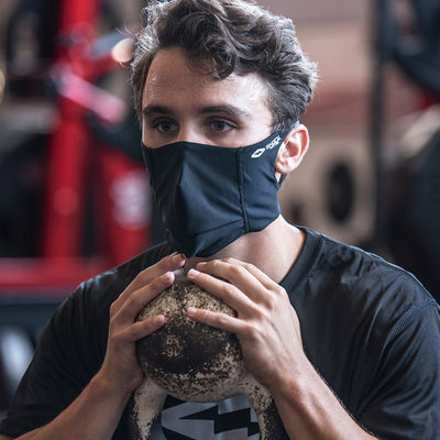 Black Play Safe Face Mask Lifestyle Image – Male Model Wearing Protective Safety Face Mask in the Gym while doing Squats - Left Angle