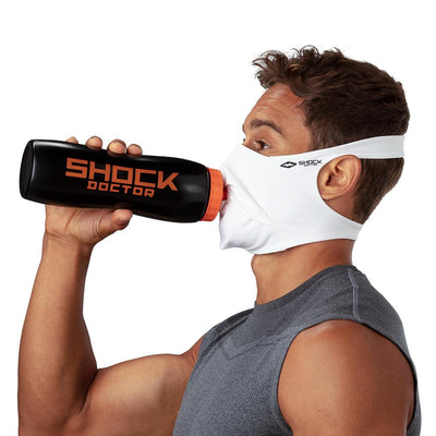 White Play Safe Face Mask – Male Model Wearing Protective Safety Face Mask while Drinking a Hydration Water Bottle - Left Angle