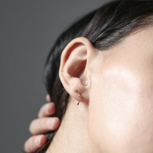 Crystal Huggie Earrings on model