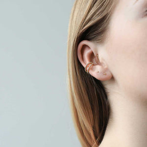 Tiny Trinity Studs in 14k Gold on model