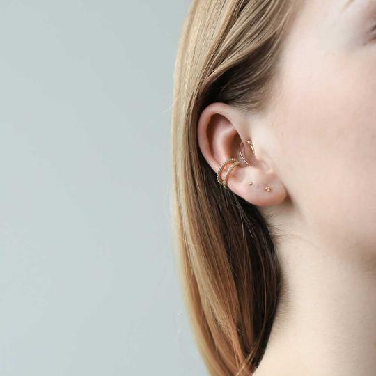 Tiny Trinity Threaded Flat Back Earring on model