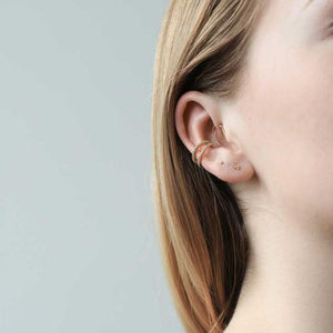 Tiny Trinity Threaded Flat Back Earring in 14k Gold on model