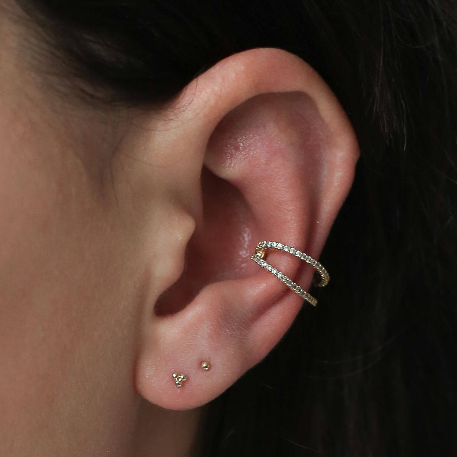 Tiny Secret Studs in Sterling Silver on model