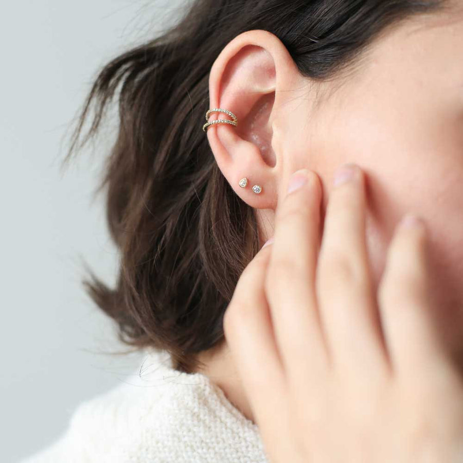 Tiny Dewdrop Studs in Sterling Silver on model