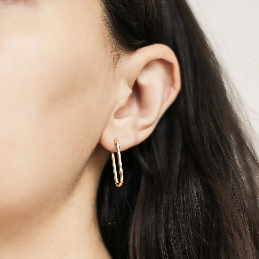 Halo Oval Hoop Earrings in Sterling Silver on model