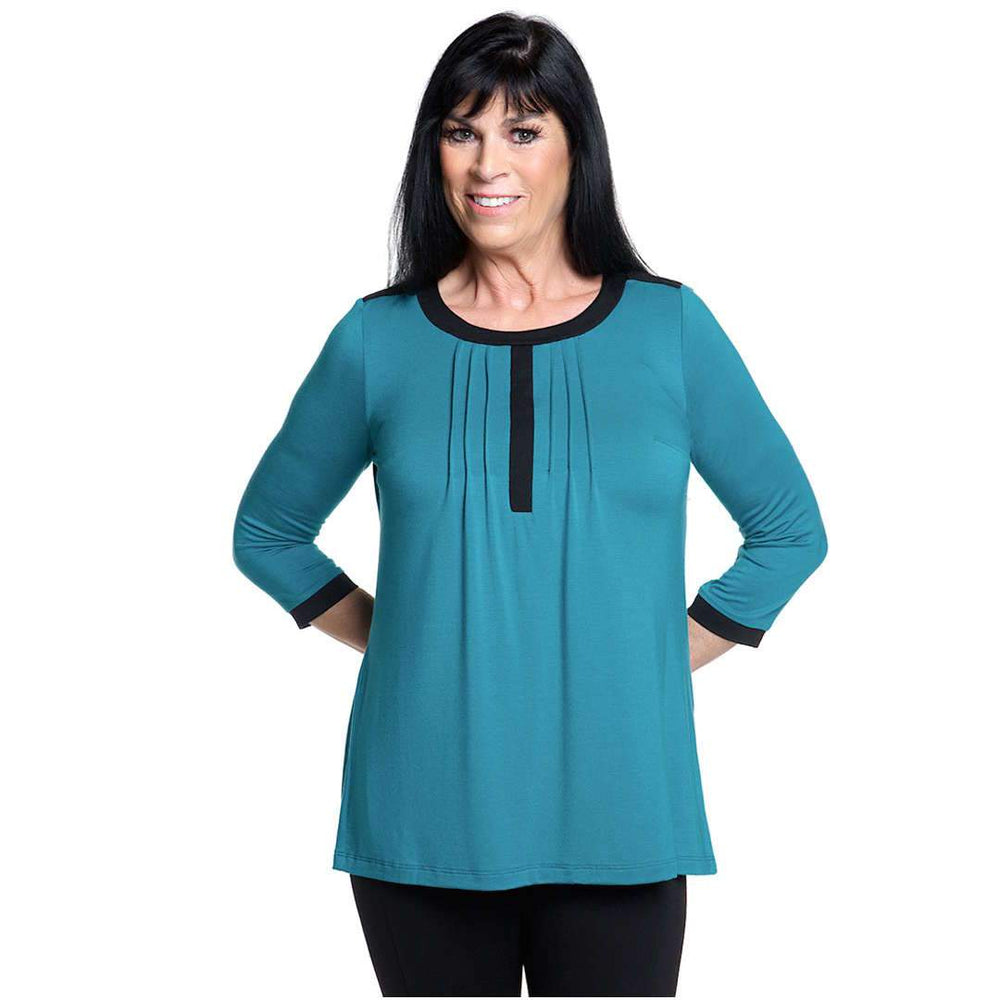 Teal women's top with black piping