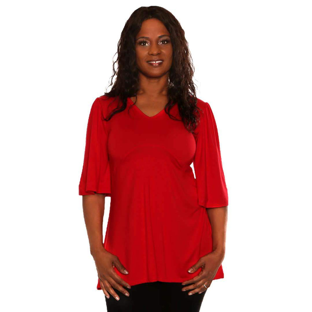 Red women's top with empire waist and asymmetrical hemline
