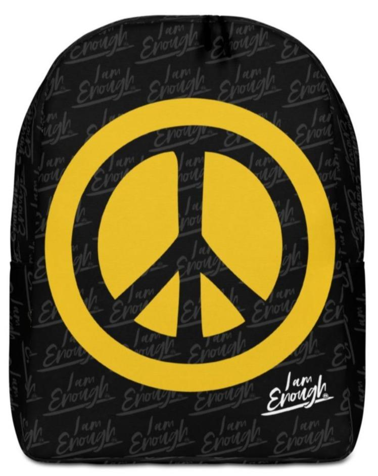 "I AM ENOUGH PEACE SIGN BACKPACK - If you feel like you're carrying half of your belongings with you at all times, then this I AM ENOUGH Peace Sign Backpack is for you! It has a large inside pocket with a separate pocket for a 15"" laptop and a hidden pocket with zipper on the back of the bag.  Your life's purpose and your dreams are limitless because you are Enough! Believe it. Live it. Wear it. Stand up and be counted! ❤"